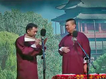 BOLD: A screen grab of the video shows Wang (L) using a traditional fan as a prop as he jokes with Zhang (R) in a performance that heavily satirized communist authorities. (The Epoch Times)