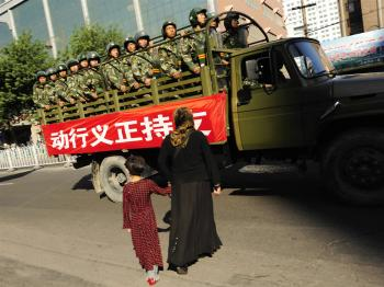 After the regime occupied Xinjiang, it created racial division and hatred. The public should clearly see its tricks, and the real evil insidious one is the Chinese communist regime. (Peter Parks/AFP/Getty Images)