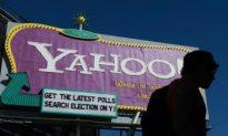 Yahoo Reports Fourth-Quarter Loss as Yang Exits