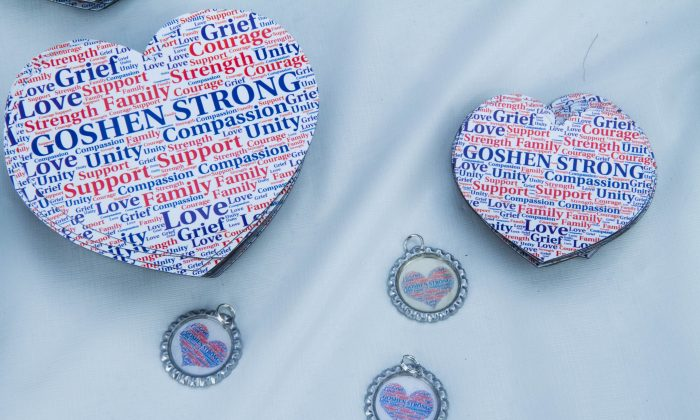 Magnets and pendants with the Goshen Strong logo at the Goshen Strong Community Picnic on the lawn of the First Presbyterian Church in Goshen on Aug. 29, 2015. (Holly Kellum/Epoch Times)