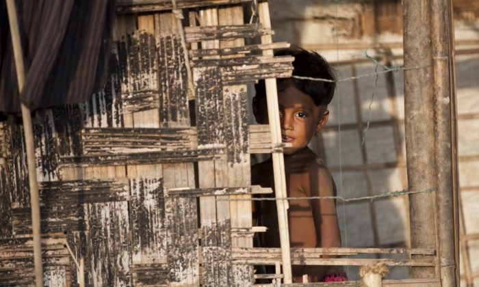 An ethnic Rohingya Muslim child in a camp set up outside the city of Sittwe, in Rakhine State, Burma, on May 21, 2015. Malaysia ordered search and rescue missions on May 22 for thousands of boat people stranded at sea, as Myanmar hosted talks with US and Southeast Asian envoys on the migrant exodus from its shores. (Ye Aung Thu/AFP/Getty Images)