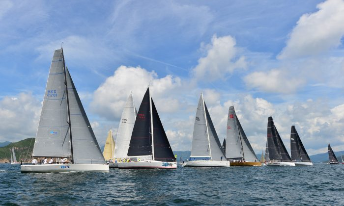 IRC-A boats set off from Trio Island to Mirs Bay in Race-7 of the Hebe Haven Quest Yachting Series on Saturday Aug 1, 2015. (Bill Cox/Epoch Times)