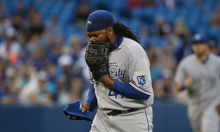 Ace pitcher Johnny Cueto hopes to bring a World Series title to the Kansas City after being traded from Cincinnati. (Tom Szczerbowski/Getty Images)