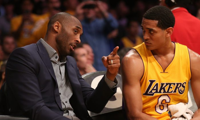 Kobe Bryant #24 of the Los Angeles Lakers talks on the bench with Jordan Clarkson #6 during the game with the Detroit Pistons at Staples Center on March 10, 2015 in Los Angeles, California. (Stephen Dunn/Getty Images)