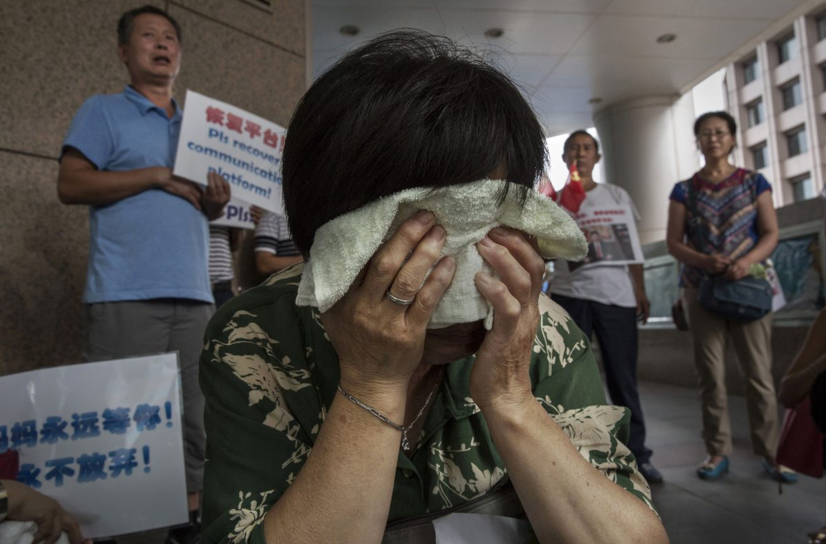 Bao Lanfang, a Chinese relative of missing passengers on Malaysia Airlines flight MH 370 cries as she waits for information outside the airline's office on August 6, 2015 in Beijing, China. Malayasia's Prime Minister announced on Thursday that a piece of wing discovered washed up on Reunion Island last week is from Malaysia Airlines Flight MH 370 which vanished on March 8, 2014. (Kevin Frayer/Getty Images)