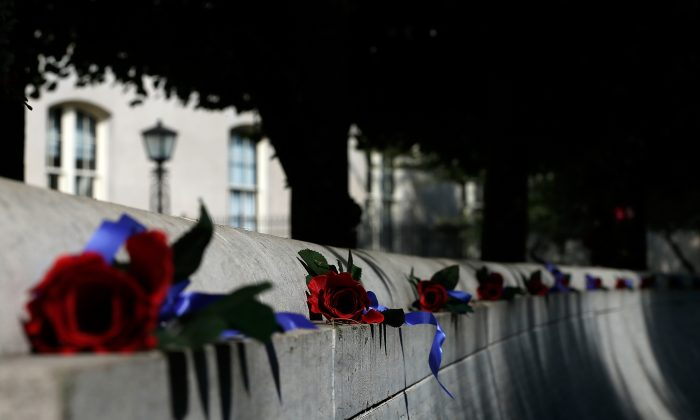 A line of red roses above the National Law Enforcement Memorial on the 13th anniversary of the 9/11 attacks, in Washington, D.C., on on Sept. 11, 2014. 72 law enforcement officers died in the line of duty on Sept. 11, 2001, more than on any other day in American history. (Win McNamee/Getty Images)
