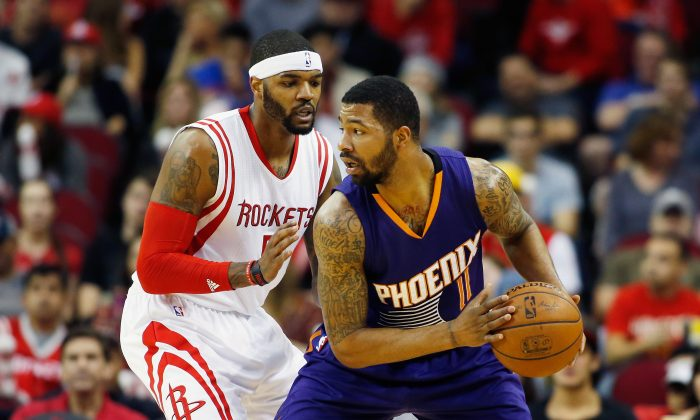 Markieff Morris #11 of the Phoenix Suns looks to pass the basketball as Josh Smith #5 of the Houston Rockets defends during their game at the Toyota Center on March 21, 2015 in Houston, Texas. (Photo by Scott Halleran/Getty Images)