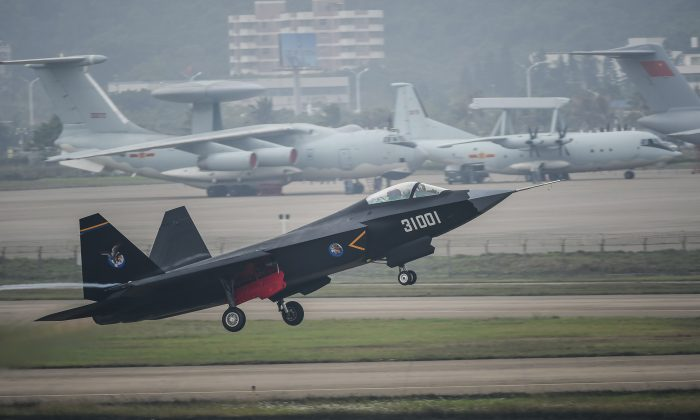 A J-31 stealth fighter takes off for test flight in Zhuhai, south China's Guangdong Province, on Nov. 10, 2014. (AP Photo/Xinhua, Liu Dawei)