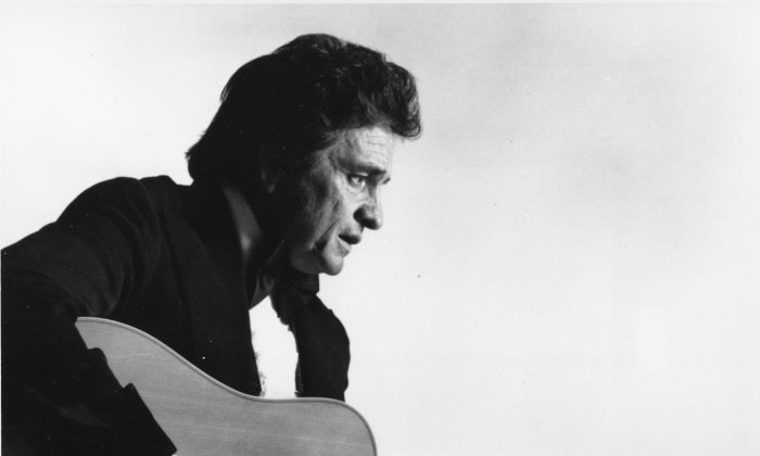 **FILE** This is a 1977 file photo of country western musician Johnny Cash. A concert marking the 40th anniversary of Cash's famous concert at Folsom State Prison scheduled for Sunday, Jan. 13, 2008, has been scraped, with the prison and the promoter blaming each other for the cancellation. (AP Photo, file)