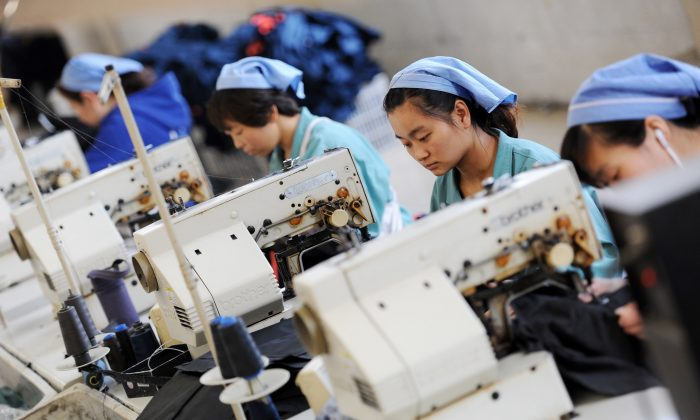 Workers produce clothes in a factory in China's Anhui Province in 2014. (STR/AFP/Getty Images)