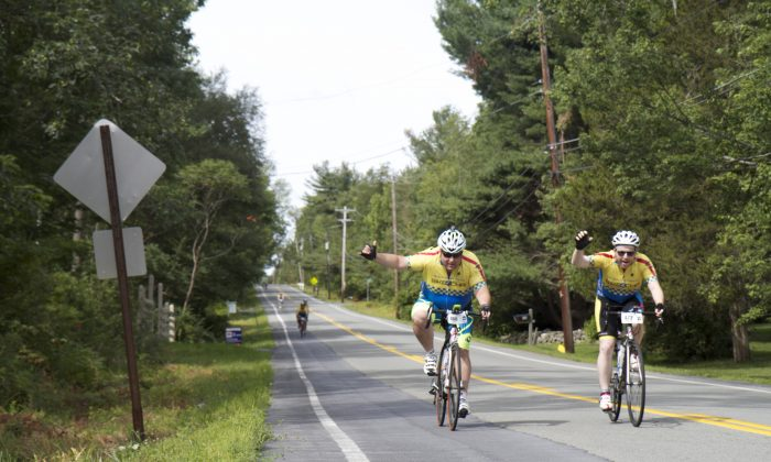Bike 4 Chai cyclists #460 and #473 ride down Guymard Turnpike towards the Mount Hope Park in Otisville, NY, on day two of the 180 mile charity ride, on Thursday, Aug. 6, 2015. (Katy Mantyk/Epoch Times)