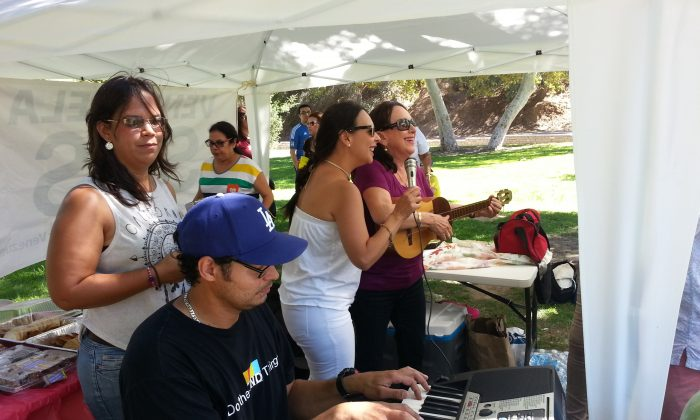 """Musicians play at a gathering in Griffith Park, July 26, to promote the transformation of a strip of Western Ave. in Los Angeles to become """"Little Venezuela"""". (Timothy Wahl)"""