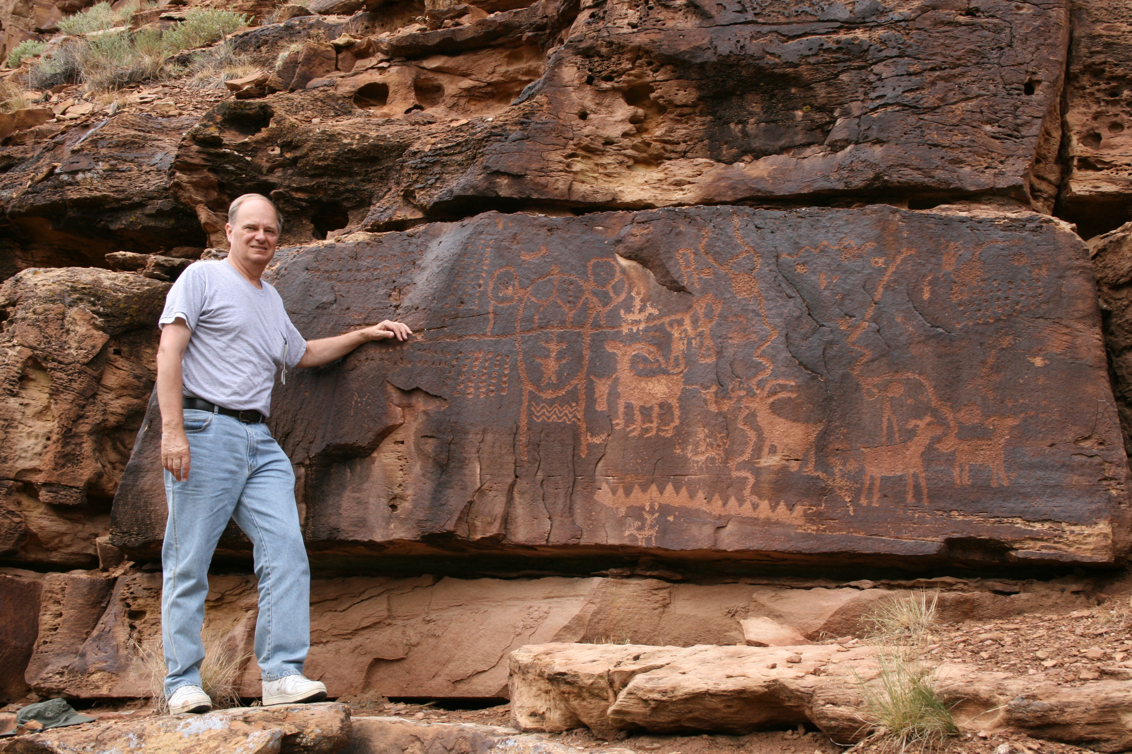 John A. Ruskamp stands near petroglyphs that match ancient Chinese script in Nine Mile Canyon, Utah. (Courtesy of John A. Ruskamp)