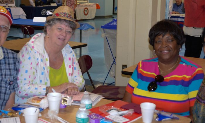 (L-R) Lou and Marlene Ferrara, Annie Michael, and Mulu Meshesha at the Orange County Senior Forum at SUNY Orange in Middletown on Aug. 14, 2015. (Yvonne Marcotte/Epoch Times)