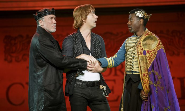 """(L–R) Patrick Page, Hamish Linklater, and Teagle F. Bougere in The Public Theater's Free Shakespeare in the Park production of """"Cymbeline."""" In a refreshingly funny production, the cast play multiple roles. Here Linklater plays foolish Cloten, possibly heir to the throne. (Carol Rosegg)"""