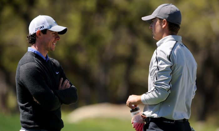 Rory McIlroy of Northern Ireland talks with Jordan Spieth on the 6th hole during the first round of the Valero Texas Open at the AT&T Oaks Course at TPC San Antonio on April 04, 2013 in San Antonio, Texas. (Photo by Steve Dykes/Getty Images)
