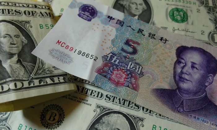 Yuan banknotes and US dollars on a table in Yichang, central China's Hubei province on Aug. 14. (STR/AFP/Getty Images)