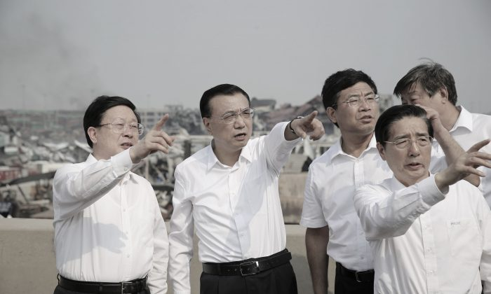 Chinese premier Li Keqiang (2nd L) inspecting the site of the massive explosions in Tianjin. (STR/AFP/Getty Images)