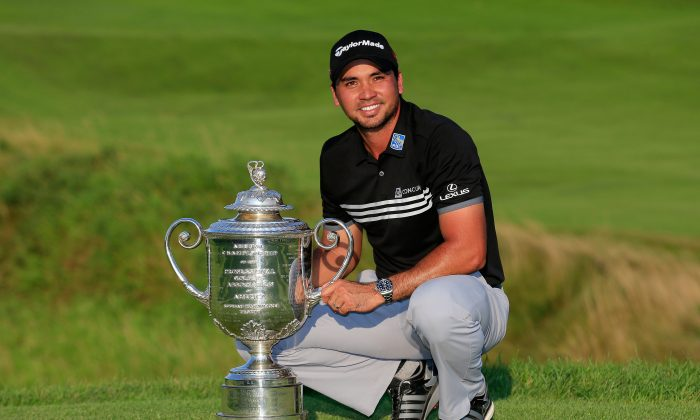 Jason Day of Australia poses with the Wanamaker Trophy after winning the 2015 PGA Championship with a score of 20-under par at Whistling Straits on August 16, 2015 in Sheboygan, Wisconsin. (Tom Pennington/Getty Images)