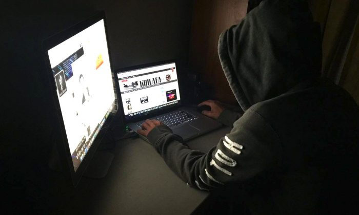 Anti-terrorist hacker WauchulaGhost works at a laptop. He released a list of close to 100 pro-ISIS websites to support cyberattacks to fight terrorism online. (WauchulaGhost)