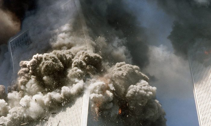 The south tower of New York's World Trade Center (L) begins to collapse after a terrorist attack on the buildings on Sept. 11, 2001. (Gulnara Samoilova/AP)