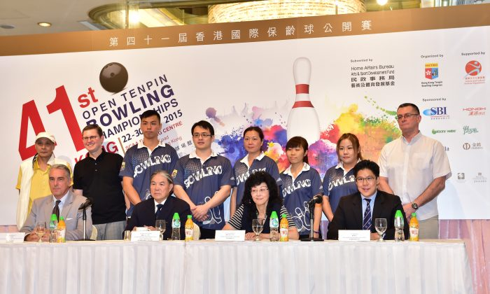 Top table guests (seated) together with the Hong Kong Team Manager, Coaches and five seeded Hong Kong bowlers in the Masters Open competitions during the Opening Ceremony for the 41st Hong Kong International Tenpin Bowling Championships at the Regal Hotel on Thursday August 20, 2015. The tournament will take place between August 22 and August 30 at the South China Athletic Association Bowling Centre in Causeway Bay. (Bill Cox/Epoch Times)