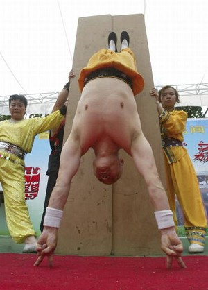 A handstand supported by only 4 fingers. (Getty Images)