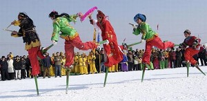 Performers walking on stilts. (Getty Images)