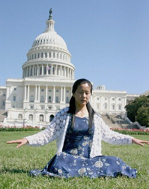 Ms. Li Weixun doing Falun Gong exercises in front of Capital Hill. Photo: The Epoch Times