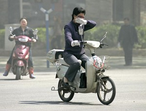 A motorist covered her nose against the severe air pollution (AFP/Getty Images)