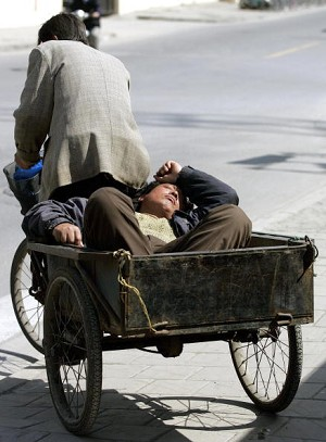 Pedicab carries both goods and passenger (AFP/Getty Images