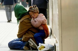 A beggar and her child (Getty Images)
