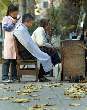 Roadside barbershop (AFP/Getty Images)