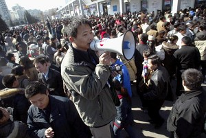 Beijing: trying to maintain order outside an employment exposition (AFP/Getty Images)