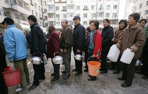 HARBIN, CHINA: Residents queue for water in the northern Chinese city of Harbin, 25 November 2005, where a spillage of carcinogenic benzene severely polluted one of China's biggest rivers. Water supplies in the city were cut for millions of people. (Peter Parks/AFP/Getty Images)