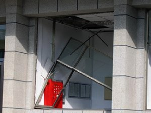 A window frame made of aluminum alloy of Jilin PetroChina Cultural Club, 0.248 miles from the accident, fell out of position. (The Epoch Times)