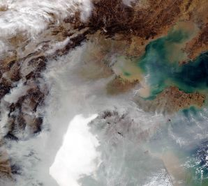 Nasa satellite image shows hazy air spread out across a wide area of eastern China. Most of China&#039s energy comes from burning coal; the emissions often pile up over the low-lying coastal plain. (Ho/AFP/Nasa)