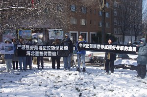 Falun Gong practitioners hold a press conference in front of the Chinese Embassy (The Epoch Times)
