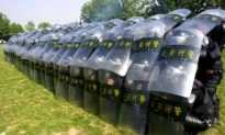 Dozens Injured as Police, Farmers Clash in China