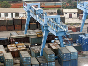 A giant crane unloads cargo containers at a train yard in Beijing. (Goh Chai Hin/AFP/Getty Images)
