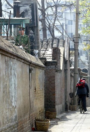 A soldier mans the watchtower monitoring the entrance of Zhao's residence on April 14, 2004. (Getty Images)