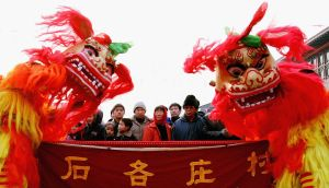 People watch a lion dance at a temple fair to mark the Chinese New Year in Beijing. People are making preparations for the New Year which falls on January  (Guang Niu/Getty Images)