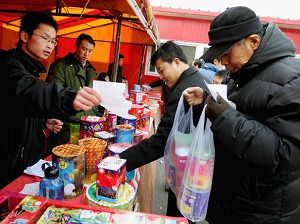 People shop for fireworks and firecracker to prepare for China's lunar new year on January 26, 2006, in Beijing, China. (Guang Niu/Getty Images)