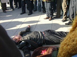 Police beat this appellant until he fell, unconscious, to the ground, January 7, 2006. (The Epoch Times)