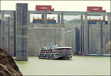 HUBEI, CHINA: A test ship passes through the Three Gorges Dam in Yichang, central China's Hubei province, in June 2003. China began construction of the first of four major hydropower plants on an strategically-important river, in a controversial project that has raised environmental concerns.(AFP/File)