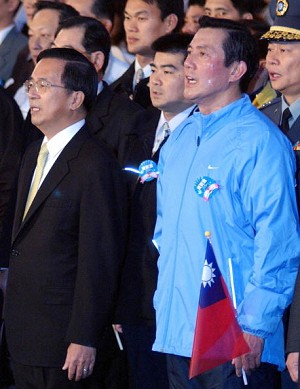 Taiwan's President Chen Shui-bian (L) and opposition leader Ma Ying-jeou (R) sing the national anthem while attending a flag-raising ceremony on the square of Taipei's Presidential Office. China has upped its accusations towards Chen of increasing tensions across the strait, but has offered two Pandas as a token of peace. (Patrick Lin/AFP/Getty Images)