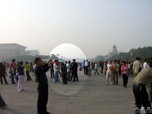 Police conducting bag and body searches on Tiananmen Square. They arrest people as soon as they discover materials for making appeals. (The Epoch Times)