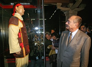 CONNOISSEUR HISTORIAN: French president Jacques Chirac looks at a statue wearing traditional clothes at the Liu Qi grave museum in Xian on a recent state visit to China. (Patrick Kovarik/AFP/Getty Images)