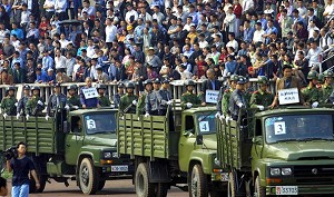 Trucks carrying condemned prisoners parade in front of thousands of spectators who turned up to watch their executions at a stadium in Chengdu, China's southwestern Sichuan province. (AFP/Getty Images)