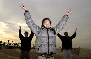 Cindy Lee practices Falun Dafa exercises at Santa Monica State Beach in Santa Monica, CA. (David McNew/Newsmakers)
